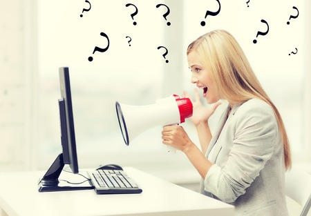 trainer device: picture of strict businesswoman shouting in megaphone Stock Photo