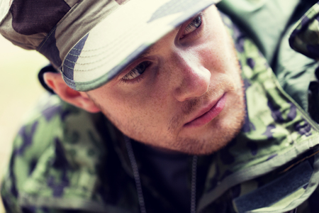infantryman: war, army and people concept - close up of young soldier in military uniform