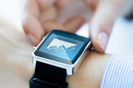lose up: business, technology, progress, statistics and people concept - lose up of hands with diagram chart on smartwatch screen