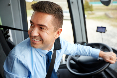 driver: transport, tourism, road trip and people concept - happy driver driving intercity bus