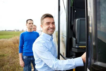 buses: transport, tourism, road trip and people concept - group of happy male passengers boarding travel bus