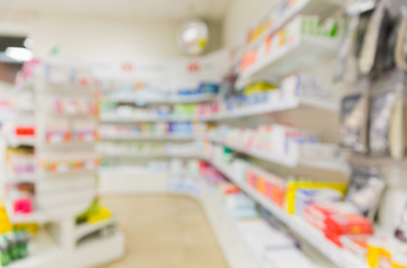 pharmaceutic: medicine, pharmacy, health care and pharmacology concept - pharmacy or drugstore room blurred background
