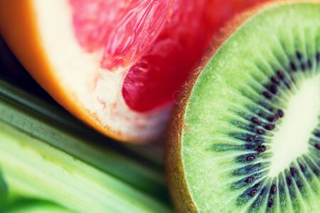 kiwi: diet, food, healthy eating and objects concept - close up of ripe kiwi and grapefruit slices