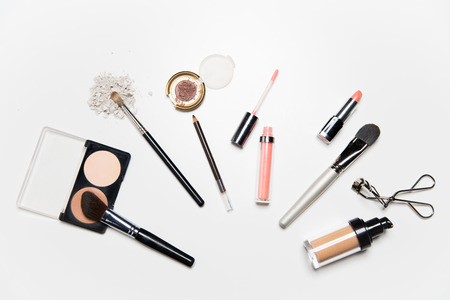 view woman: cosmetics, makeup and beauty concept - close up of makeup stuff