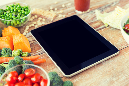 healthy eating, dieting, slimming and weigh loss concept - close up of black blank tablet pc screen and vegetables