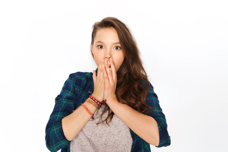 hispanic kids: people, emotion, expression and teens concept - scared teenage girl