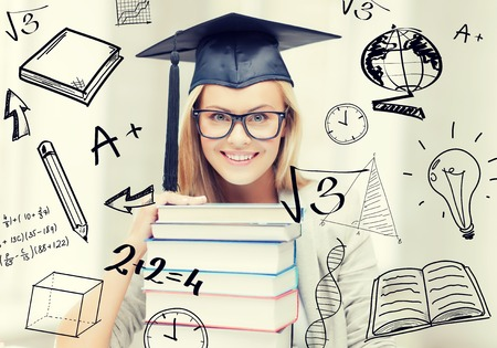 education and university concept - happy student in graduation cap with stack of books and doodles Stock Photo