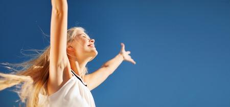 happy woman: lifestyle concept - beautiful happy woman enjoying summer outdoors Stock Photo