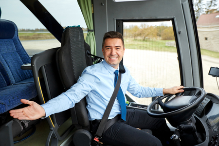 transport, tourism, road trip, gesture and people concept - happy driver inviting on board of intercity bus Imagens - 59097621