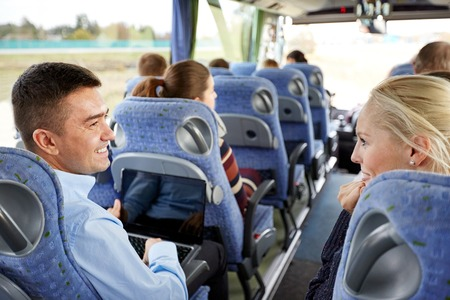 touristic: transport, tourism, road trip and people concept - group of happy passengers or tourists in travel bus