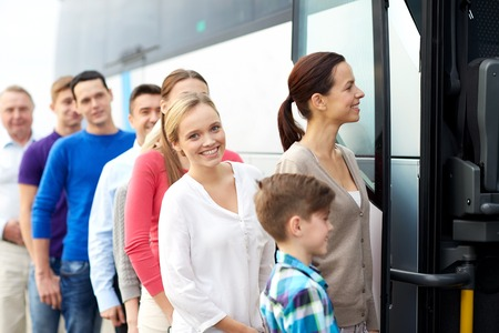 transport, tourism, road trip and people concept - group of happy passengers boarding travel bus Standard-Bild