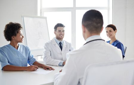 health care and medicine: hospital, medical education, health care, people and medicine concept - group of happy doctors meeting at medical office