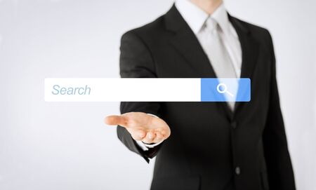 browser business: people, business, technology and networking concept - close up of man hand showing internet browser search bar projection Stock Photo