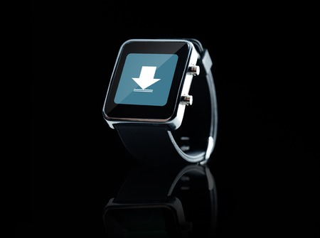 close icon: modern technology, object and media concept - close up of black smart watch with download icon on screen