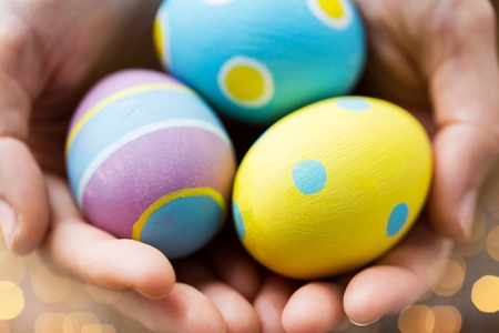 easter, holidays, tradition and object concept - close up of colored easter eggs Stock Photo