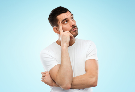 mistrust: doubt, expression and people concept - man thinking over blue background