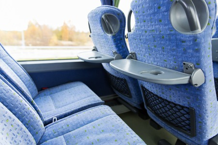 touristic: transport, tourism, road trip and equipment concept - travel bus interior and seats