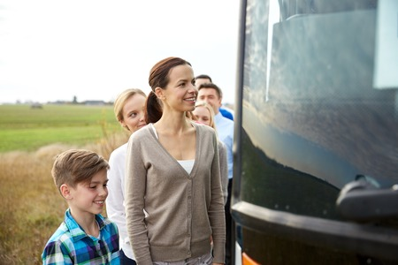 buses: transport, tourism, road trip and people concept - group of happy passengers boarding travel bus Stock Photo