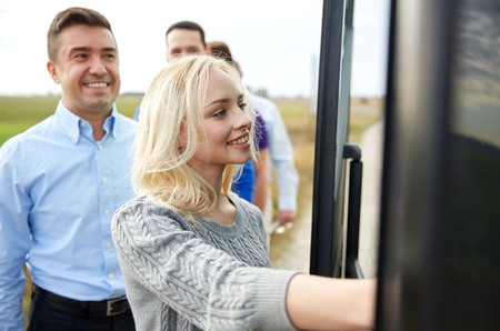 many people: transport, tourism, road trip and people concept - group of happy passengers boarding travel bus Stock Photo