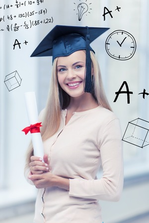young students: education and school concept - happy student in graduation cap with certificate