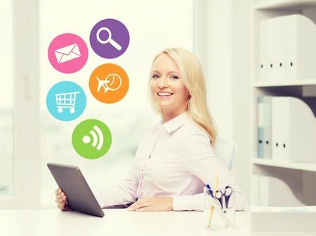 internet education: education, business and technology concept - smiling businesswoman or student with tablet pc computer and internet icons in office