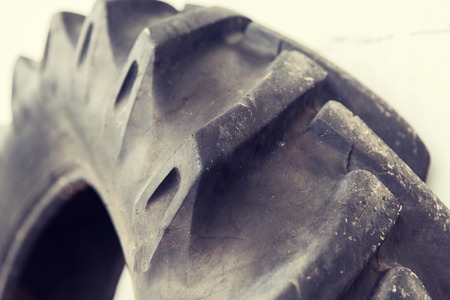 utilized: tire, maintenance, service and motor transport concept - close up of truck wheel tyre