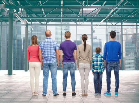 family, gender, generation and people concept - group of men, women and boy from back over terminal with window city view background