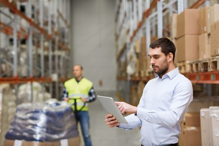 wholesale: wholesale, logistic, business, export and people concept - man or manager with tablet pc computer checking goods at warehouse