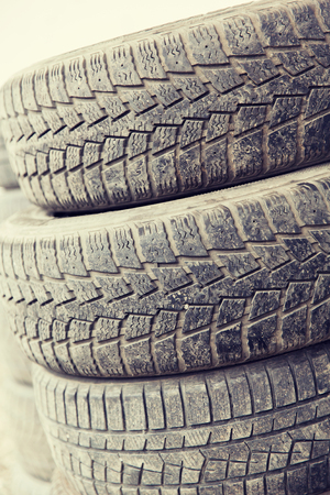utilized: tire, maintenance, service and motor transport concept - close up of wheel tyres
