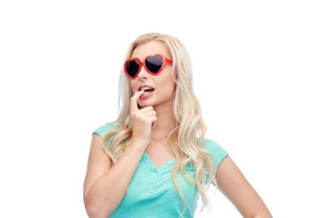 emotions, expressions, summer and people concept - smiling young woman or teenage girl in sunglasses