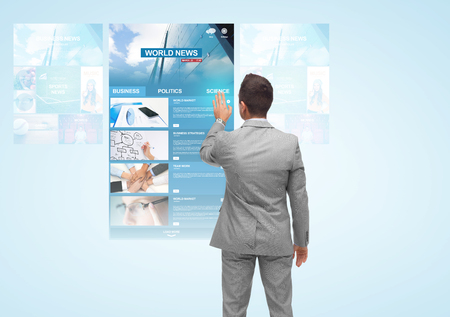 financial world: business, people, internet and mass media concept - businessman touching virtual projection with world news web page from back