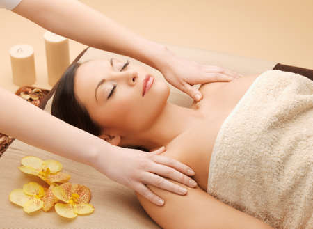 calm woman: picture of calm beautiful woman in massage salon Stock Photo