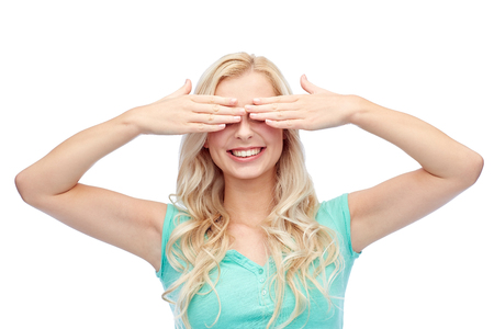 emotions, expressions and people concept - smiling young woman or teenage girl covering her eyes with palms