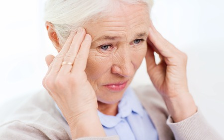 megrim: health care, pain, stress, age and people concept - face of senior woman suffering from headache