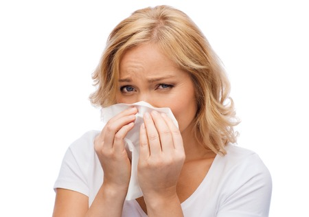 sniffle: people, healthcare, rhinitis, cold and allergy concept - unhappy woman with paper napkin blowing nose