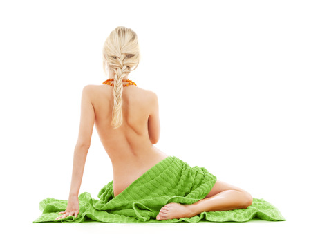 people, beauty, body care and spa concept - beautiful bare woman with green towel from back photo