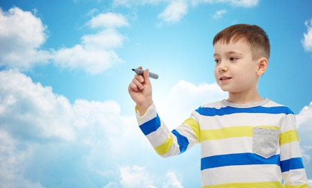 niños escribiendo: childhood, preschool education, creativity, learning and people concept - happy little girl drawing or writing something with marker over blue sky and clouds background