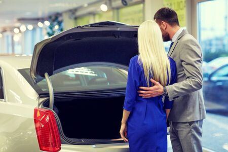 petaca: auto business, car sale and people concept - happy couple choosing car in auto show or salon