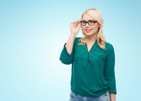 overweight students: vision, optics, education and people concept - smiling young woman with eyeglasses over blue background