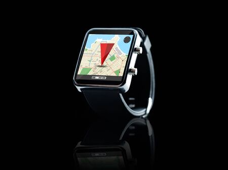 watch over: modern technology, object, application and navigation concept - close up of black smart watch with gps and road map on screen over black background Stock Photo
