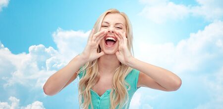 insulting: emotions, expressions and people concept - young woman or teenage girl shouting over blue sky and clouds background