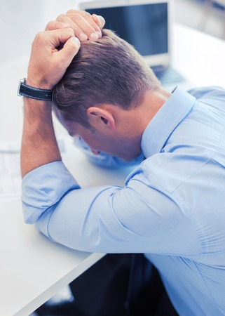 school work: business, office, school and education concept - stressed businessman with papers at work