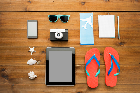 plane table: vacation, travel, tourism, technology and objects concept - close up of tablet pc computer and travel stuff Stock Photo