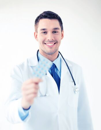 picture of young male doctor with pack of pills Stock Photo