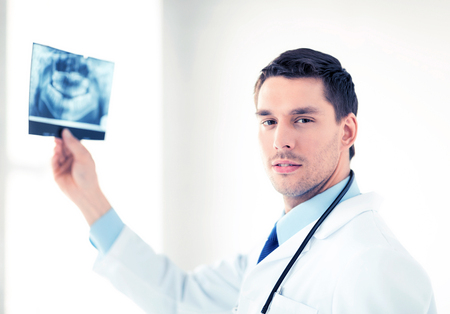 picture of male doctor or dentist with x-ray Stock Photo