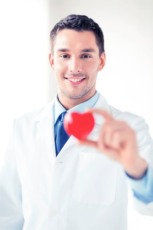 heart doctor: bright picture of male doctor with heart