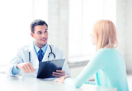 doctor patient: bright picture of male doctor with patient Stock Photo