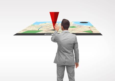 business, people, navigation and technology concept - businessman touching gps navigator map virtual projection from back Stock Photo