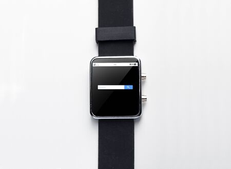 internet browser: modern technology, object and media concept - close up of black smart watch with internet browser search bar on screen
