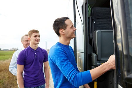 touristic: transport, tourism, road trip and people concept - group of happy male passengers boarding travel bus